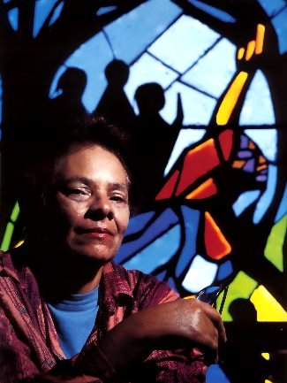 Artist Jean Lacy illuminated by the Harriet Tubman window
